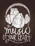 Design Of Music Poster With Anatomical Heart And Headphones On Chalkboard Royalty Free Stock Images