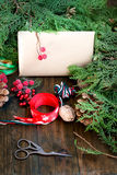 Design of a New Year gift ribbons, branches and berries Stock Photos