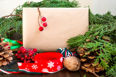 Design of a New Year gift ribbons, branches and berries Stock Photo