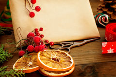 Design of a New Year gift ribbons, branches and berries Royalty Free Stock Images