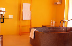 DESIGN ORANGE BATH ROOM Stock Image
