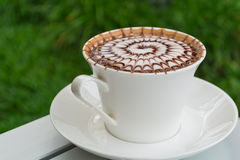 Design pattern coffee in a white cup. Stock Images