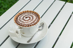Design pattern coffee in a white cup. Royalty Free Stock Image