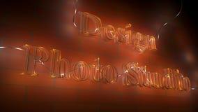 Design photo studio. Luminous letters   design photo studio   on the brick wall background Royalty Free Stock Photo