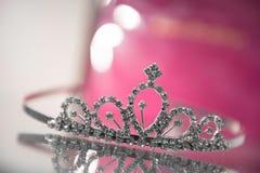 Design princess crown on glass cupboard stock image