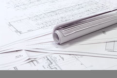 Design and project drawings. Black and white dimensional drawings are semicircle and rolled whatman papers Stock Photo