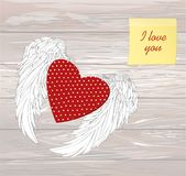 Design red heart with wings. Yellow sheet of paper for notes. St. Icker. I love you. Vector on wooden background Royalty Free Stock Photography