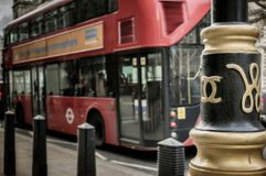 London bus, chanel lamps. The design resembles the logo of fashion designer and perfumer Coco Chanel, which reflects her initials. Is this an early example of Stock Photo