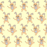 Design seamless pattern with cartoon rabbits Stock Image