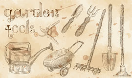 Design set with garden tools on paper background. Vintage set with garden tools with hand drawn elements on old paper background royalty free illustration