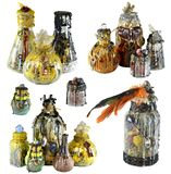Design set with group of magic witch bottles isolated on white. Wicca, esoteric, divination and occult concept with vintage magic objects for mystic rituals royalty free stock image