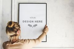Design space photo frame hanging on the wall Stock Photo