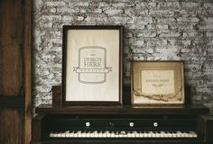 Design space photo frames by the piano Royalty Free Stock Images