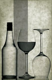 Design spirits. Wine glasses and bottle with graphic abstract grunge background Stock Images