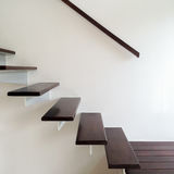 Design stairway. Consists of metal and wood in luxury home stock images