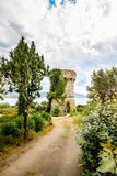 Design stone tower in the middle of the garden. Beautiful architecture royalty free stock photos