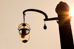 Design street lamp post in sun set scene Royalty Free Stock Images