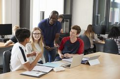Design Students With Teacher Working In CAD/3D Printing Lab royalty free stock photography