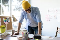 Design Studio Architect Creative Occupation Blueprint Concept. Male Architect Studying Plans In Office stock photography