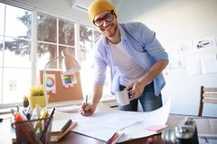 Design Studio Architect Creative Occupation Blueprint Concept. Male Architect Studying Plans In Office royalty free stock photography
