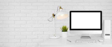 Design studio concept with workplace and white brick wall background.  royalty free stock photos