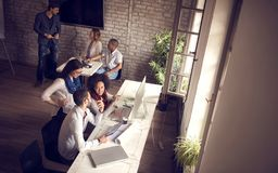 Design studio with employees and female manager royalty free stock image