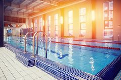 Athletes in the gym. Design of swimming pool in gym royalty free stock photos