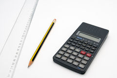 Design table. With calculator, ruler and pencil Royalty Free Stock Photos
