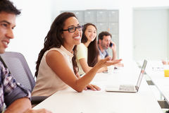 Design Team Collaborating On Project Together stock photo
