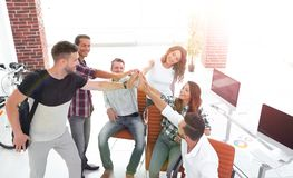 Design team giving each other a high five. The concept of teamwork royalty free stock photo