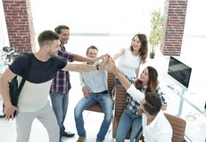 Design team giving each other a high five Stock Photo