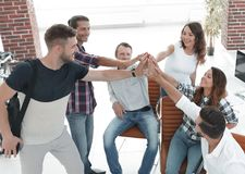 Design team giving each other a high five. The concept of teamwork royalty free stock images