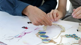 Design team looking at costume jewelry Royalty Free Stock Photography