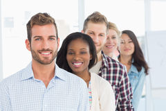 Design team standing in a line smiling at camera Royalty Free Stock Photo