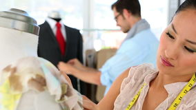 Design team working on clothes on mannequins Stock Images
