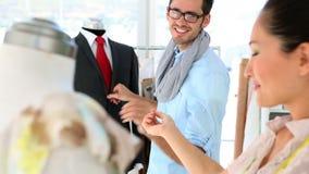 Design team working on mannequins stock footage