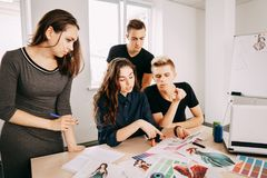 Fashion designers team at work royalty free stock photos