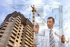 Design technologies in building. The engineer-designer develops a residential building construction plan Stock Photos