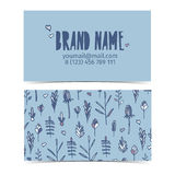 Design Template business cards for corporate identity with a pattern of flowers and plants. Floral background blue. A Stock Images