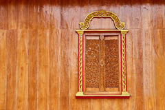 A design of a Thai style window. Made of Teak wood Royalty Free Stock Photo