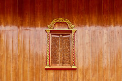 A design of a Thai style window. Made of Teak wood Royalty Free Stock Images