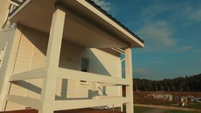 Country house. Design two-storey country house with a total area of 70 square meters, on the banks of the river where you can live with a family of 6 people. Two stock video