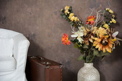 Design vintage interior with flowers in a vase suitcases and cha Royalty Free Stock Photography