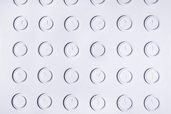 Design white wall with identical round white not numeral wall clocks. Time concept background Stock Image