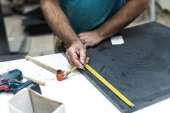 Design wood concept. Cropped photo of cabinetmaker handyman trad stock photos