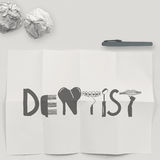 Design word DENTIST on white crumpled paper and texture Royalty Free Stock Images