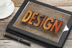 Design word on digital tablet stock image