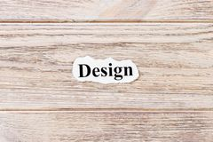 Design of the word on paper. concept. Words of Design on a wooden background royalty free stock photo