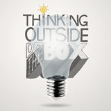 Design word THINKING OUTSIDE OF THE BOX. Lightbulb 3d and design word THINKING OUTSIDE OF THE BOX as concept Royalty Free Stock Image