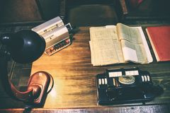 Design working office: antique table and analog telephone, lamp on table. royalty free stock photos